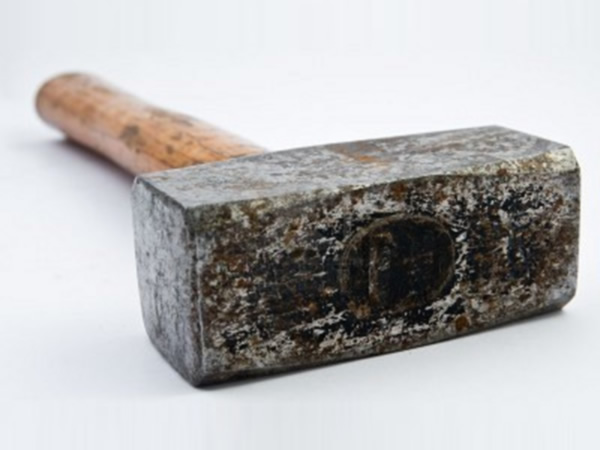 Photo of a large hammer as a last resource in how to get clients to pay on time