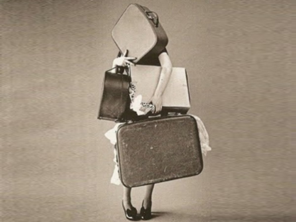 This image of a woman holding lots of luggage is used in a blog on writing short copy by freelance copywriter Caroline Gibson to make the point that it's very easy for copy to have too much baggage and so you need to cut out jargon and unnecessary words to make the copy lighter