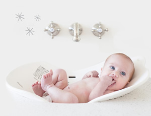 Picture of a baby in an ergonomically designed bath which is one of the products on the Me & Buddy website, with category copy by freelance copywriter Caroline Gibson