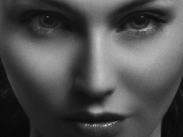 A black and white photo of a beautiful girl's face used in Caroline Gibson's aesthetic marketing strategy blog