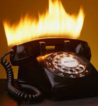 Photo of a black phone on fire as a metaphor for being busy as a freelance copywriter with tips on how to get more work if not in Caroline Gibson's blog on copywriting lessons learned over 25 years