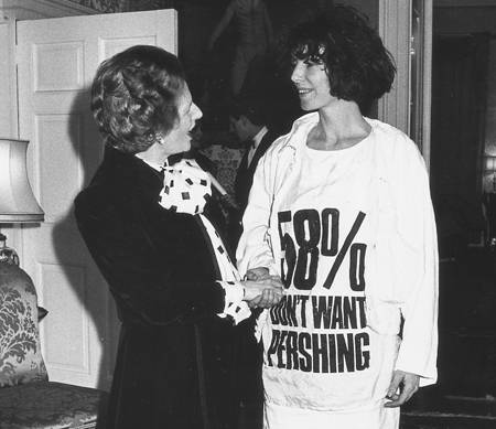 to show Difference Between A Headline, Strapline, Tagline And Slogan, this photo of Margaret Thatcher meeting Katharine Hamnett wearing a T-shirt with a slogan