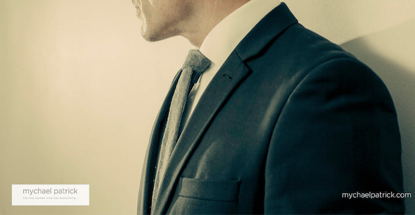 Photo of a man in a suit which is a private male escort client, which links to the blog by Caroline Gibson about her work with him when writing a website for his elite escort services