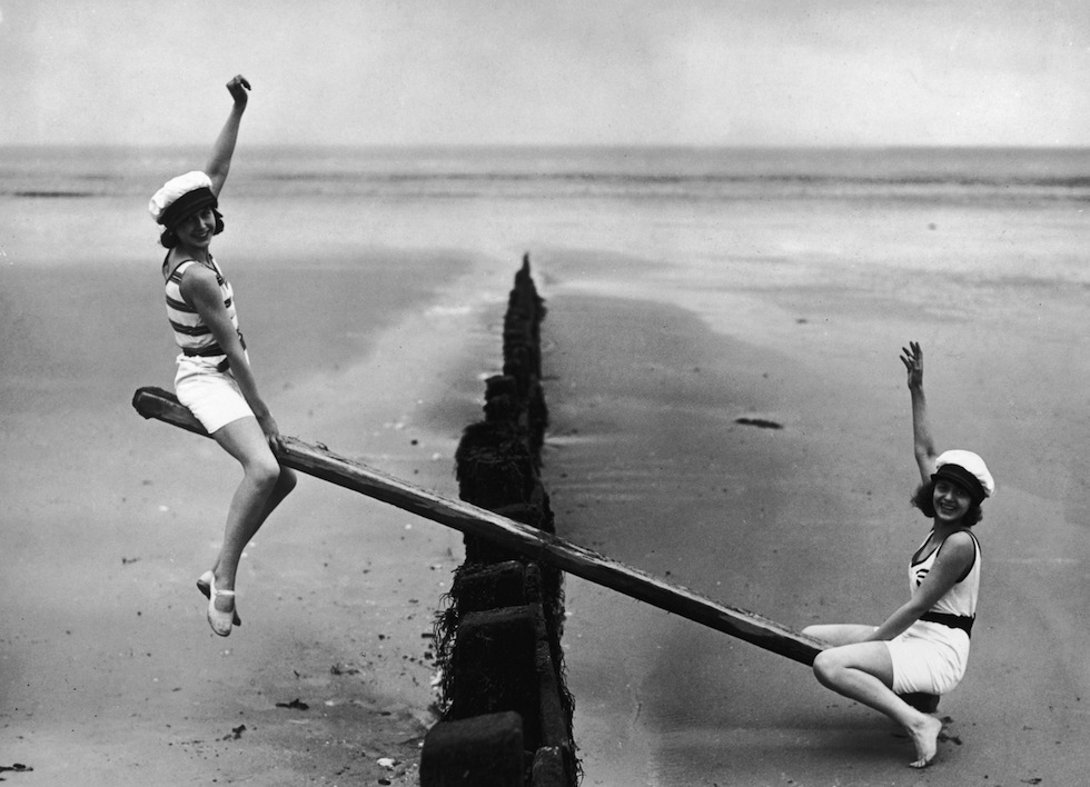 Two girls on a see saw is a metaphorical image for the ups and downs of working life as a freelance copywriter and important to consider of thinking about how to become a freelance copywriter