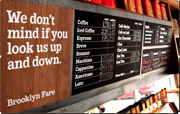 Photo of Brooklyn Fare display material with coffee prices to show the importance of consistency in copy style and tone of voice, as explained in Caroline Gibson's blog about tone of voice for brands