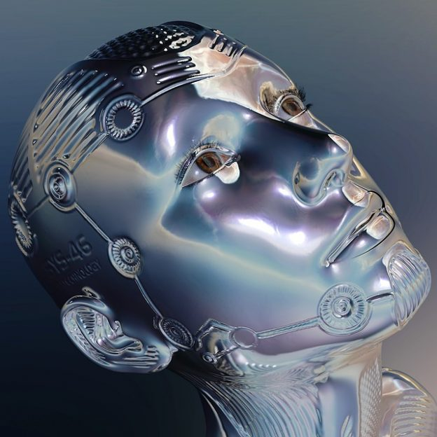 Photograph of a robot's metallic face in Caroline Gibson's copywriting blog about AI robot writing and whether human freelance copywriters will ever be replaced by AI robot writers and what advantages artificial intelligence has over human intelligence for writing copy.