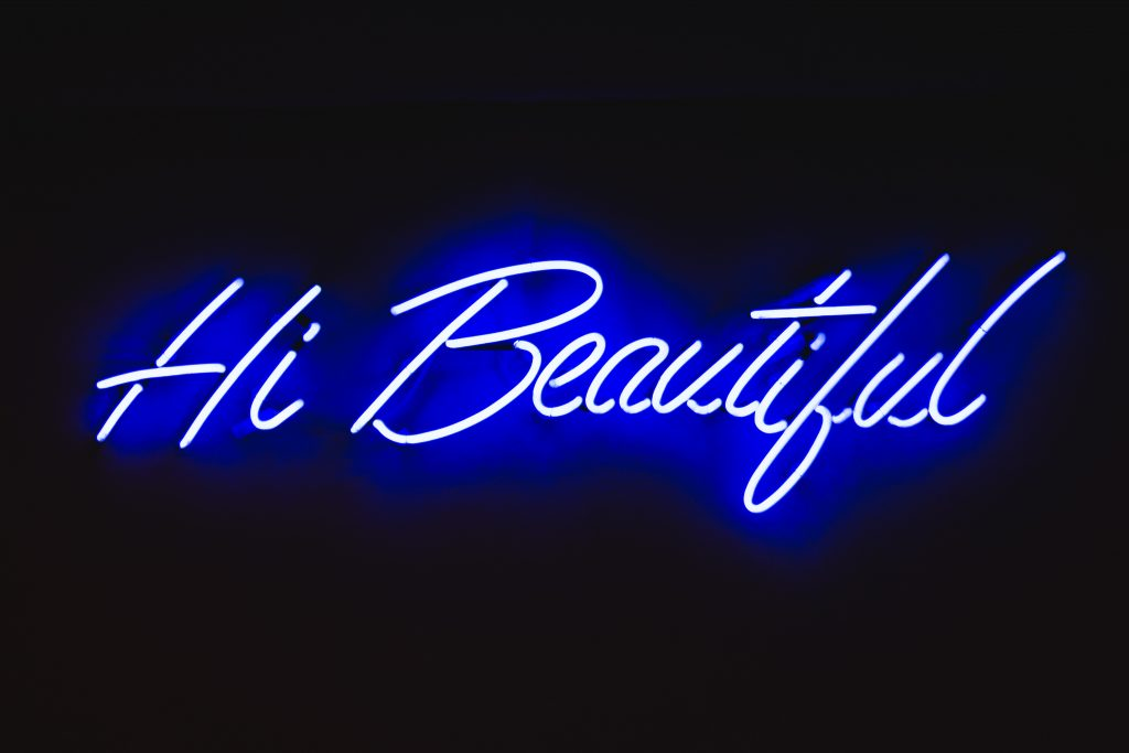 A sign saying Hi Beautiful to introduce freelance copywriter Caroline Gibson's blog about non-surgical aesthetics clinics and beauty brands and the importance of creating a unique tone of voice to help them stand out