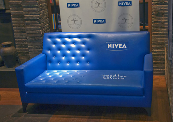Ad showing a blue sofa with one half that's smooth and the other with bumps, which was a guerrilla campaign by Nivea promoting cellulite cream and a great example of an eye-catching aesthetic marketing strategy