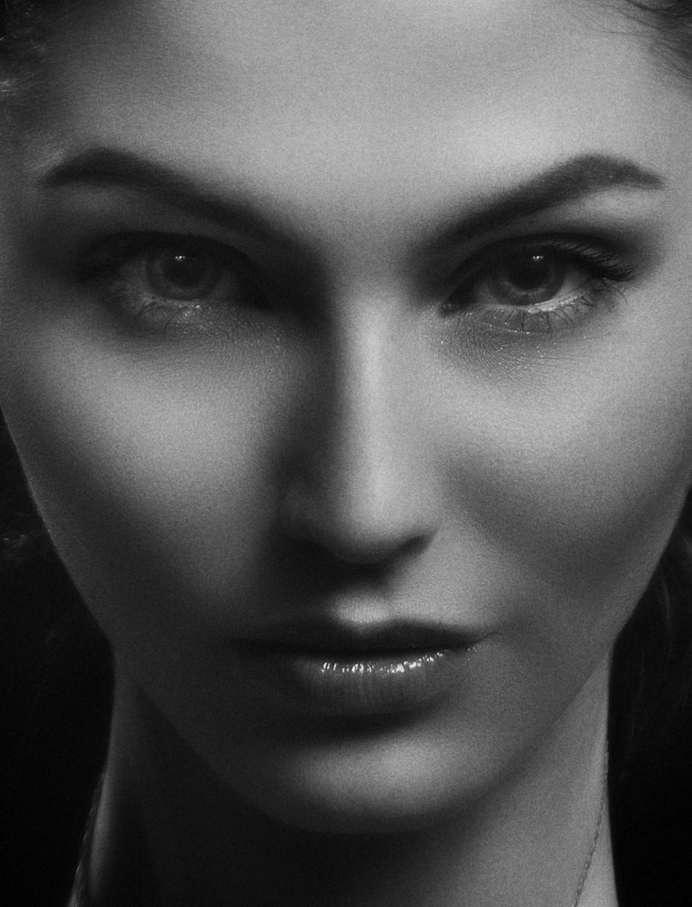 A black and white photo of a beautiful girl's face used in creating a successful aesthetic marketing strategy in Caroline Gibson's copywriting blog