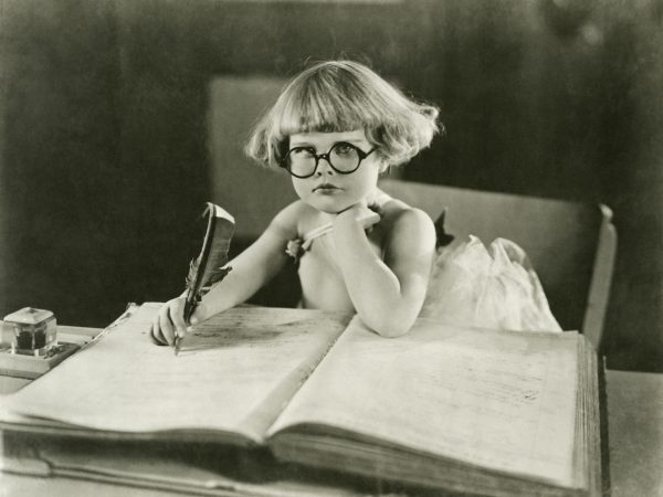 B&W photo of a girl writing for Caroline Gibson's blog on differences between copywriting and blogging