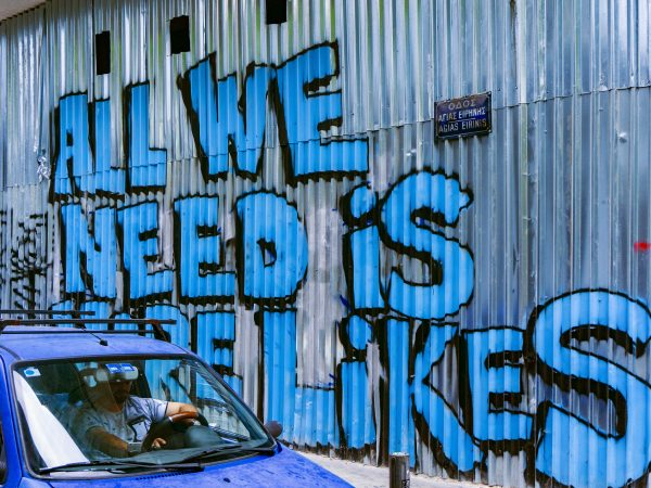 Graffiti saying 'Al we need is more likes' to illustrate Caroline Gibson's copywriting blog on social media engagement